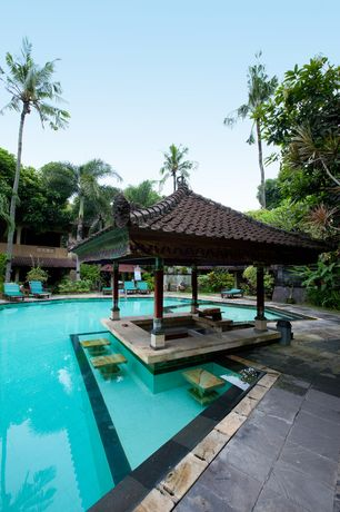 Asian Swimming Pool with Pool with hot tub, 8' Solid Wood Column, exterior stone floors, Liquid Seat, exterior tile floors