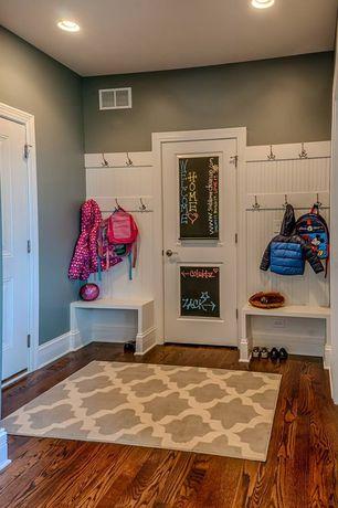 Cottage Mud Room with Built-in bookshelf, Wainscotting, specialty door, can lights, Standard height, Hardwood floors