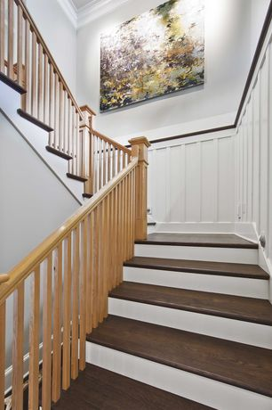 Traditional Staircase with Crown molding, Chair rail, Wainscotting, Board and batten, Paint, Eyebrow step lighting