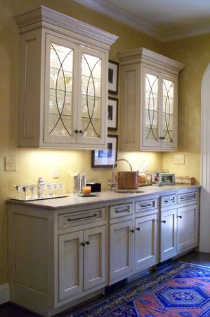 Traditional Bar with Hardwood floors, Arched window, Crown molding, Built-in bookshelf, French doors