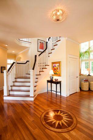 Traditional Hallway with Wainscotting, Standard height, Hardwood floors, flat door, Chandelier, specialty window