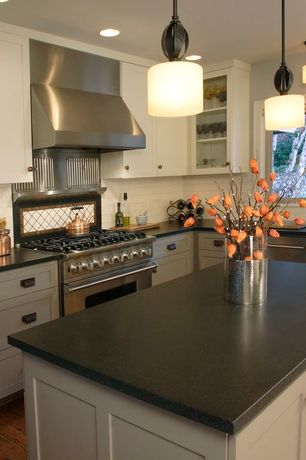 Contemporary Kitchen with Subway Tile, Flat panel cabinets, Chantal copper tea kettle, Kitchen island, L-shaped, Flush