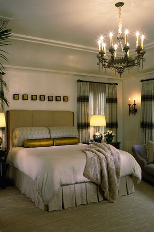 Traditional Master Bedroom with Crown molding, Wall sconce, Standard height, Chandelier, Carpet