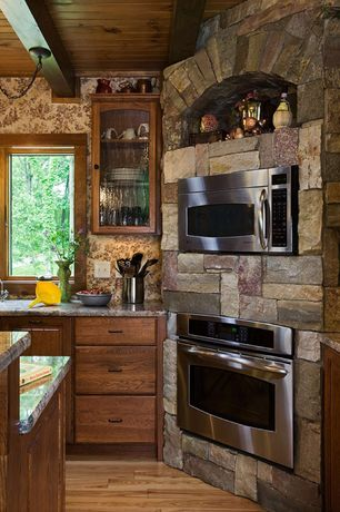 Rustic Kitchen with Complex granite counters, Exposed beam, Hardwood floors, Kitchen island, Electrolux Wall Oven, L-shaped