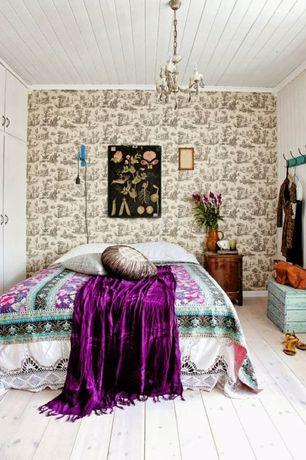 Eclectic Guest Bedroom with Crown molding, Chandelier, Standard height, interior wallpaper, Hardwood floors