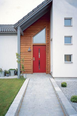 Contemporary Front Door with Pathway, exterior brick floors, Glass panel door, Transom window