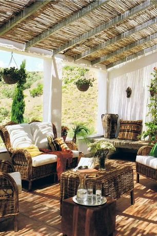 Tropical Porch with Wrap around porch, exterior tile floors, exterior terracotta tile floors