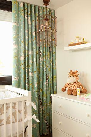 Contemporary Kids Bedroom with Built-in bookshelf, Elemental crib, Standard height, Bird cage chandelier, White dresser