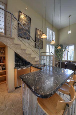 Eclectic Bar with Pendant light, High ceiling, Built-in bookshelf, limestone tile floors