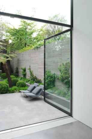 Contemporary Patio with Fence, Raised beds, exterior tile floors, French doors, exterior concrete tile floors