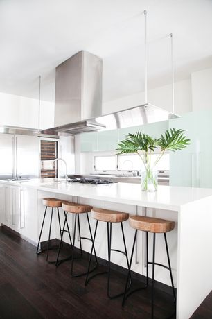 Modern Kitchen with Aria bar stool, Quartz countertop, Boffi Integrated range hood with suspended lighting, Hardwood floors