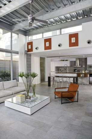 Contemporary Great Room with Concrete tile , Ceiling fan, Pendant light, Built-in bookshelf, Exposed beam, French doors