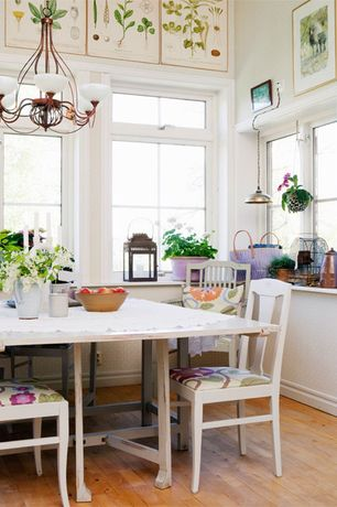 Cottage Dining Room with Pendant light, High ceiling, Chandelier, Casement, picture window, Built-in bookshelf