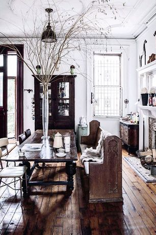 Traditional Dining Room with Hardwood floors, Standard height, Built-in bookshelf, double-hung window, Pendant light, Paint