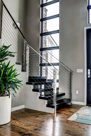 Contemporary Staircase with Cathedral ceiling, Hardwood floors