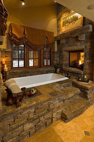 Rustic Master Bathroom with M rock screws manufactured stone - ledge stone, Stacked stone fireplace, High ceiling
