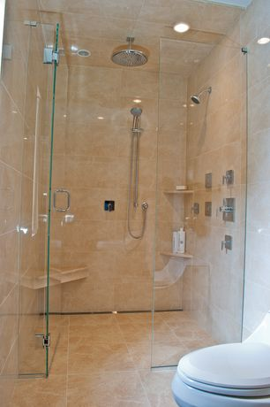 Contemporary Master Bathroom with Frameless glass shower door, can lights, stone tile floors, Built in bench seat