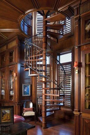 Traditional Staircase with Built-in bookshelf, Spiral staircase, Hardwood floors, Exposed beam, High ceiling, Wall sconce