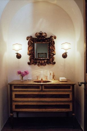Traditional Powder Room with Wall sconce, specialty door, Inset cabinets, Wood counters, High ceiling, Hardwood floors
