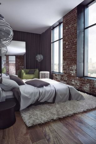 Contemporary Master Bedroom with picture window, Pendant light, Hardwood floors, interior brick, Standard height