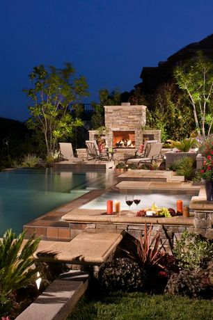 Traditional Patio with Round polyresin mesa planter, Outdoor fireplace, Infinity pool, Pool with hot tub, Outdoor seating