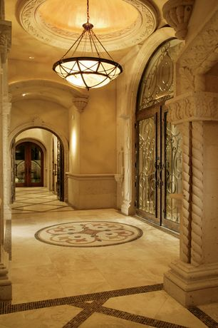 Mediterranean Entryway with Arched iron entry door fse-019, Transom window, can lights, French doors, High ceiling
