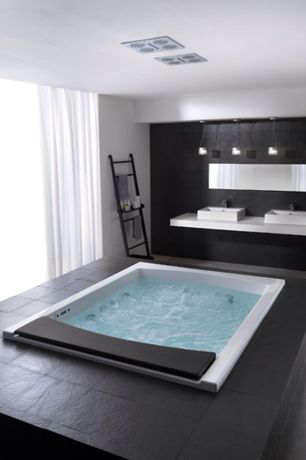 Modern Master Bathroom with Wall Tiles, full backsplash, Concrete floors, Vessel sink, Master bathroom, Stone Tile, Bathtub