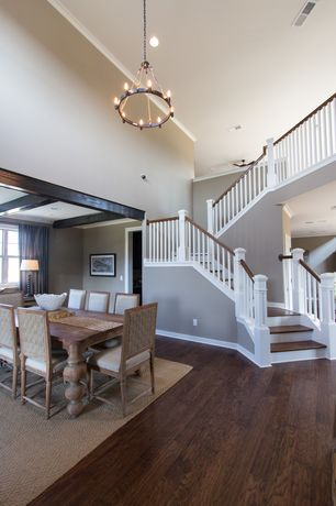 Traditional Staircase with Loft, can lights, curved staircase, Crown molding, Cathedral ceiling, Chandelier, Hardwood floors