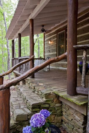 Rustic Porch with Wrap around porch, exterior stone floors