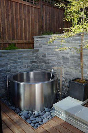 Contemporary Hot Tub with exterior stone floors, Pathway, Raised beds, Stainless steel soaking tub, Fence