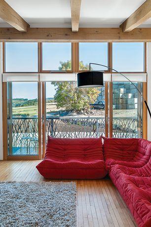 Contemporary Living Room with Transom window, Exposed beam, Hardwood floors