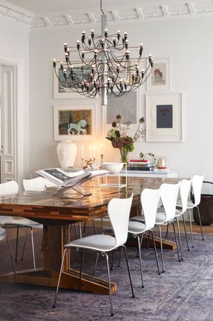 Contemporary Dining Room with Hardwood floors, Standard height, Chandelier, Crown molding