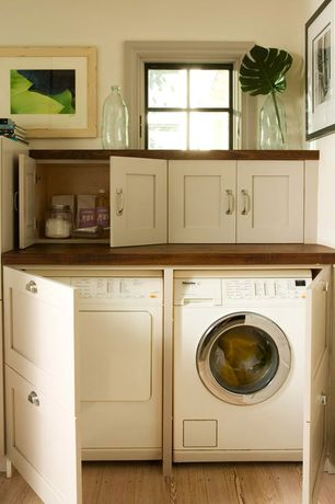 Traditional Laundry Room with Standard height, Flat panel cabinets, Hardwood floors, picture window, Built-in bookshelf