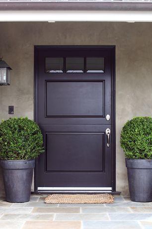 Traditional Front Door with Restoration hardware estate zinc round planter, Pathway, exterior stone floors, Dutch door