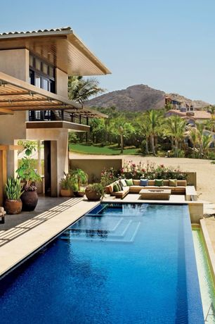 Tropical Swimming Pool with exterior tile floors, Raised beds, Lap pool, Trellis