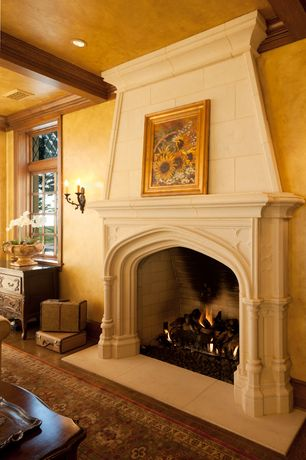 Traditional Living Room with Standard height, Hardwood floors, Fireplace, Exposed beam, Wall sconce, Casement, can lights