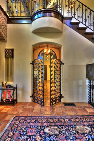 Mediterranean Entryway with Loft, specialty door, Capel Piedmont Persian Area Rug, Cathedral ceiling