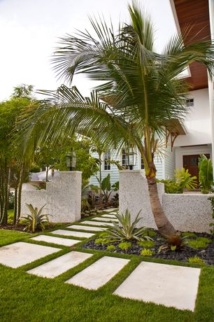Tropical Landscape/Yard with Fence, Pathway, French doors, exterior stone floors