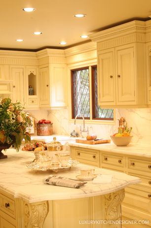 Traditional Kitchen with Farmhouse sink, Inset cabinets, Standard height, full backsplash, Kitchen island, can lights