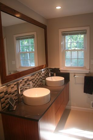 Contemporary Full Bathroom with Ceramic Tile, double-hung window, Vessel sink, European Cabinets, Soapstone counters, Flush