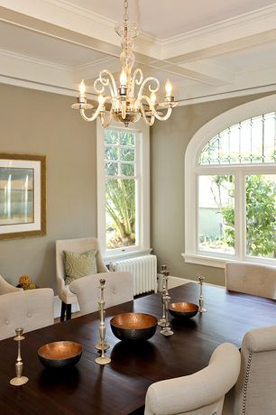 Traditional Dining Room with Chandelier, Box ceiling, Hardwood floors, Crown molding, Arched window