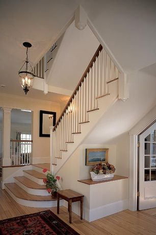 Traditional Staircase with Chandelier, Floating staircase, Hardwood floors, Columns, High ceiling, Wall sconce, Crown molding
