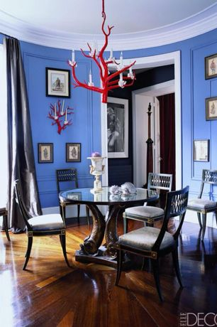Contemporary Dining Room with Paint, Hardwood floors, Three fish table with glass top, Standard height, Crown molding