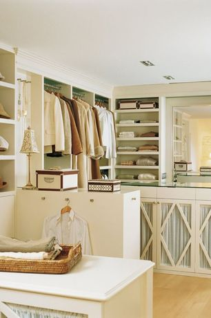 Traditional Closet with Crown molding, Built-in bookshelf, Hardwood floors