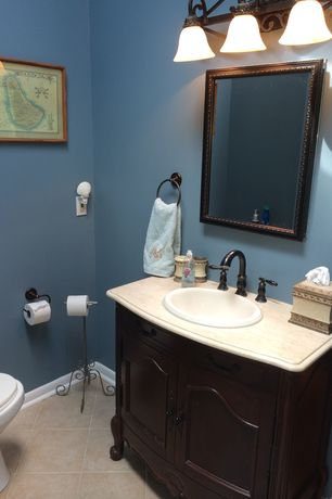 Traditional Powder Room with Inset cabinets, limestone tile floors, Golden Lighting Belle Meade 3 Light Bath Vanity Light