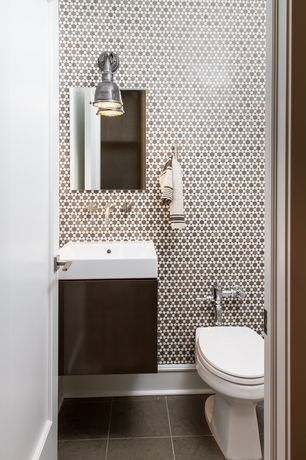 Modern Powder Room with Powder room, Vessel sink, specialty door, wall-mounted above mirror bathroom light, Standard height