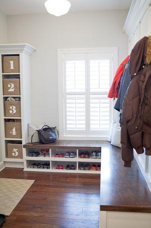 Traditional Mud Room with Kouboo rattan utility basket, Built-in bookshelf, Hardwood floors, Window seat, flush light