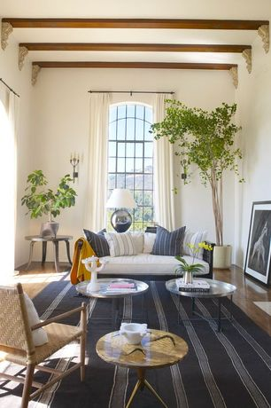 Mediterranean Living Room with High ceiling, Arched window, Hardwood floors, Exposed beam