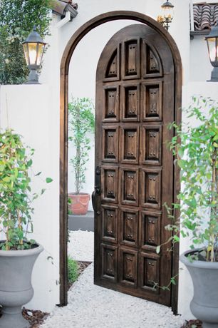Mediterranean Landscape/Yard with Gate, exterior stone floors, Greensmix 0.5-cu ft Marble Chip, Pathway, Spanish Revival