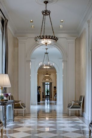 Traditional Hallway with Crown molding, Chandelier, stone tile floors, High ceiling, can lights, simple marble tile floors
